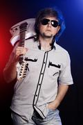 Cute young rock musician with a white guitar Stock Photos