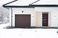 Stock Photo of Detached house during winter time