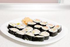 Homemade sushi in a white plate with wasabi and ginger Stock Photos