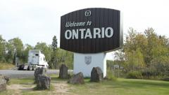 Welcom to Ontario sign with traffic passing. Manitoba Ontario border. Stock Footage