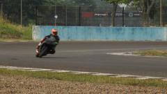 Motorcyclist making a Sharp Turn Stock Footage