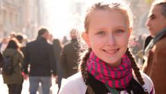 Beautiful blonde teen girl smiling street, facial expression, close up, portrait - stock footage