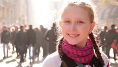 Big blue eyed blonde girl smiling street, facial expression close up slow motion - stock footage