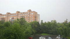 Summer rain in the city,  person goes under an umbrella, the top view Stock Footage