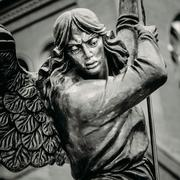 Statue Of Archangel Michael With Outstretched Wings Before Red C Stock Photos