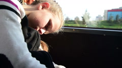 Tired teenager girl is sleeping on a bus seat Stock Footage