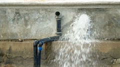 Water flow out from the tube Stock Footage