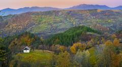 Beautiful autumn landscape and old house Stock Photos