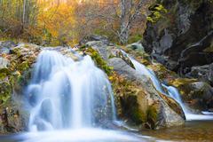 Waterfall in autumn season - stock photo