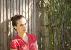 Beautiful and meditative woman - stock photo