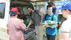 Short-Term Missions Team Prepares To Hand Out Rice In Slums Stock Footage