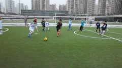 Chinese children playing football Stock Footage