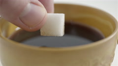Sugar cube soaked in coffee. 4K UHD - stock footage