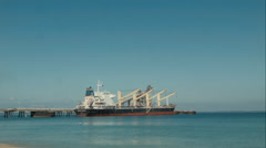 View From The Beach Of A Bulk Freighter Ship Docked Stock Footage