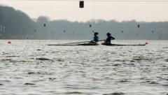 2 rowers, low angle shot over water Stock Footage