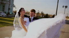 Groom carries a bride in arms Stock Footage