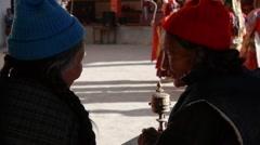 Spectators at Festival, with praying wheel,Lamayuru,Ladakh,India - stock footage