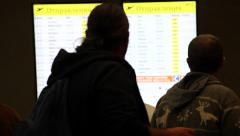 People and flight information monitor Stock Footage