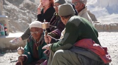 Spectators at Festival, with praying wheel,Lamayuru,Ladakh,India - stock footage