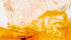 Close-up of whiskey in glass with ice used for background, whisy Stock Footage