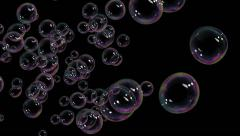 A Lot of Beautiful Soap Bubbles flying on black background. HD 1080. Stock Footage