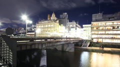 Motion Control Pan Time Lapse of Kamogawa River in Kyoto at Night -Zoom In/Out- Stock Footage