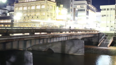 Motion Control Pan Time Lapse of Kamogawa River in Kyoto at Night -Zoom Out- Stock Footage