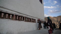 Spectators at Festival circle the Gompa,Lamayuru,Ladakh,India Stock Footage
