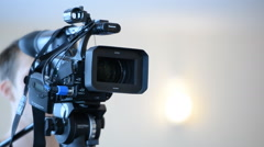 Camera operator working with a cinema broadcast Stock Footage