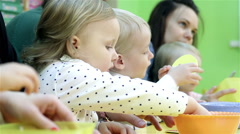 Small children and their mothers engaged in the development of intelligence - stock footage