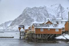 A violent and sudden snowstorm begins to fall in the Bay of Hamnoy famous for - stock photo