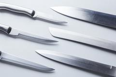 Set of steel kitchen knives, isolated Stock Photos