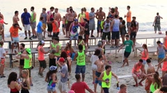 Boys and girls dance during a full moon party on Koh Phangan, Thailand Stock Footage
