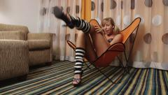 Cute girl with long legs in leg warmers talking to camera Stock Footage
