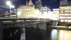 4K Motion Control Pan Time Lapse of Kamogawa River in Kyoto at Night -Zoom Out- Stock Footage