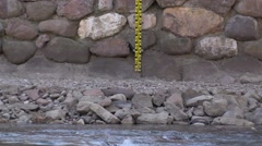 Measuring range for high water level of a river to prevent floods Stock Footage
