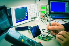 adjustment the microprocessor in a workshop - stock photo
