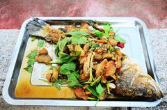 Stock Photo of Deep Fried Snapper topped with Sweet Fish Sauce Sacrificial offering