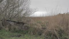 Old disused boat - pan from right and hold Stock Footage