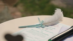 Pen for the wedding ceremony as feathers Stock Footage