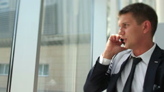 Stylish young  man talking on the phone Stock Footage