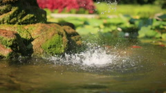 raindrop falling in to the water - stock footage