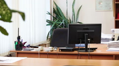 Manager calling smartphone while coming into work place in office room - stock footage