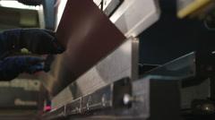 Worker Is Working On Sheet Metal Bending Machine Stock Footage