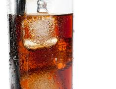 detail of fresh coke with black straw, summer time - stock photo