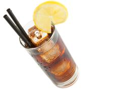 fresh coke with straw with lemon slice on top, summer time - stock photo