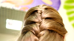 Braid hair for a little girl in a beauty salon Stock Footage