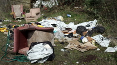 Fly tipped rubbish and chairs. - stock footage