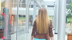 Beautiful blonde goes to the store, Slow motion Stock Footage