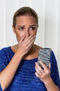 woman is shocked by sms - stock photo